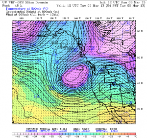 A cold upper level low off the Northwest coastline—shown here by the purple colors—will plague Seattle with bands of heavy showers Tuesday and Wednesday.