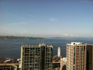 Downtown Seattle shimmers under blue skies Wednesday morning. Rain returns to the city on Thursday.