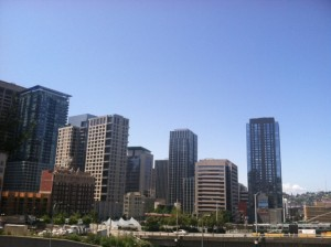 Sunshine engulfs Seattle on  an early June day. After several days of clouds, blue skies return this weekend.